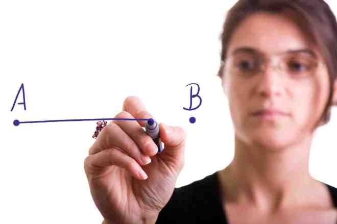 woman drawing a line from point A to point B (selective focus)